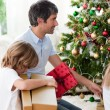 Father and his boy opening Christmas presents — Stock Photo
