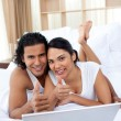 Stock Photo: Couple with thumbs up using a laptop