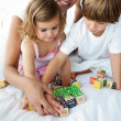 Stock Photo: Close-up of brother and sister playing with cube toys