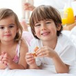 Stock Photo: Smiling siblings having breakfast