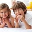 Royalty-Free Stock Photo: Cute brother and sister having breakfast