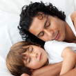 Royalty-Free Stock Photo: Little boy and his father sleeping together
