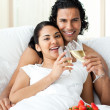 Happy couple drinking Champagne with strawberries — Stockfoto