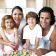 Happy family having fun with cube toys — Stock Photo #10293663