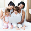 Young family using a credit card to shop online — Stock Photo