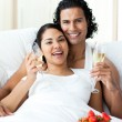 Happy young lovers drinking Champagne with strawberries — Stock Photo
