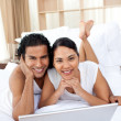 Young couple using a laptop — Stock Photo #10293753