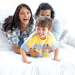 Jolly parents playing with their little boy — Stock Photo #10293758