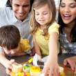 Jolly family eating cookies — Stock Photo