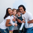 Stock Photo: Adorable children painting room with their parents