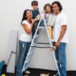 Happy young family renovating a room — Stock Photo