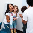 Stock Photo: Happy parents with their children painting room