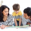 Affectionate family reading book together — Stock Photo