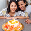 Attractive woman celebrating her birthday with her husband — Stock Photo #10293820