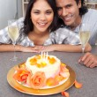 Brunette woman and her husband celebrating her birthday — Stock Photo #10293825