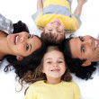 Happy family lying together on the floor in circle — Stock Photo