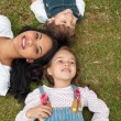 Royalty-Free Stock Photo: Happy mother and her children lying on the grass