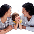 Foto Stock: Joyful family lying on the floor