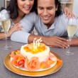 Charming man and his wife celebrating his birthday — Stock Photo
