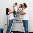 Happy family painting a room — Stock Photo