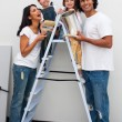 Royalty-Free Stock Photo: Smiling family painting a room