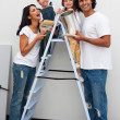 Stock Photo: Smiling family painting a room