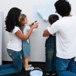 Loving parents helping their children paint — Stock Photo