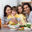 Portrait of a family in the kitchen — Stock Photo