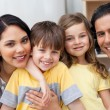 Close-up of a family hugging in the kitchen — Stock Photo