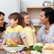 Joyful family having fun in the kitchen — Stockfoto