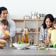 Portrait of a family preparing lunch — Stock Photo