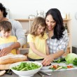 Positive family preparing lunch together — Stock Photo #10293922