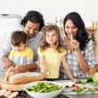 Animated family preparing lunch together — Stock Photo