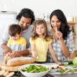 Stock Photo: Animated family preparing lunch together