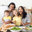 Lively family having fun in the kitchen — Foto de Stock