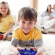 Cute little boy playing video game with his sister - Stockfoto