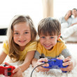 Foto Stock: Loving siblings playing video game