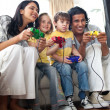 Lively family playing video game — Stock Photo