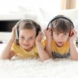 Close-up of children listening music with headphones — Stock Photo