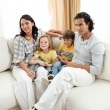 Stock Photo: Portrait of a family sitting on sofa