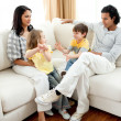 Lively family having fun in the living room — Stock Photo