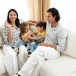 Stock Photo: Merry family having fun in the living room