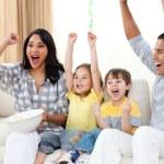 Animated family watching TV on sofa — Stock Photo