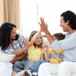 Joyful family watching TV on sofa — Stock Photo