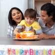 Jolly family celebrating the son's birthday — Stock Photo