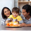 Smiling parents celebrating their son's birthday — Stock Photo #10293997