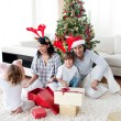 Family decorating a Christmas tree — Stock Photo #10294000