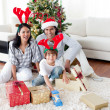 Stock Photo: Family decorating a Christmas tree