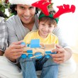 Royalty-Free Stock Photo: Father and son playing with a Christmas present
