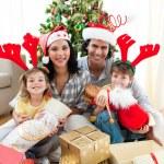Family decorating a Christmas tree — Stock Photo